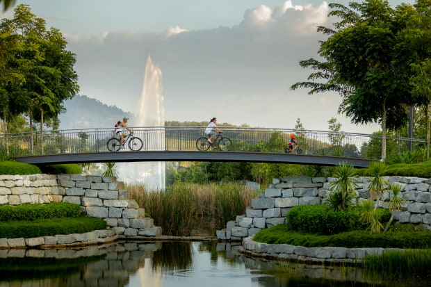 Visitors to the Waterfront Village can take a stroll or ride a bicycle along the lakeside.